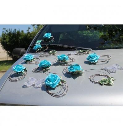 Décoration voiture mariées turquoise papillons